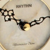 Rhythm Seashell Mantel Clock